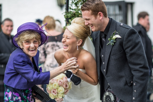 A candid photograph taken at a wedding in Marculter by Jonathan Addie, an Aberdeen based wedding photographer