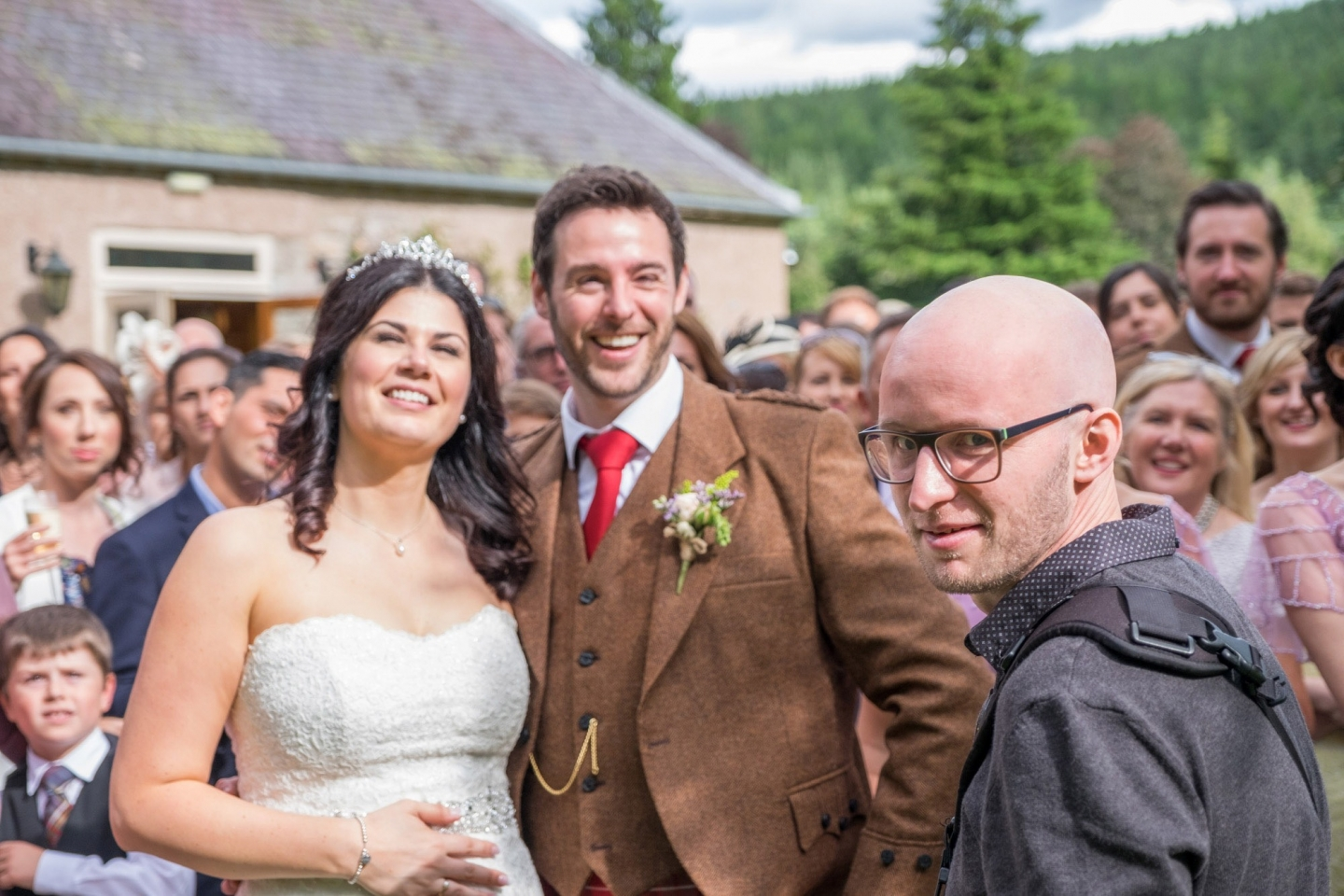 A candid photo of Jonathan Addie, an Aberdeen based wedding photographer at a wedding.